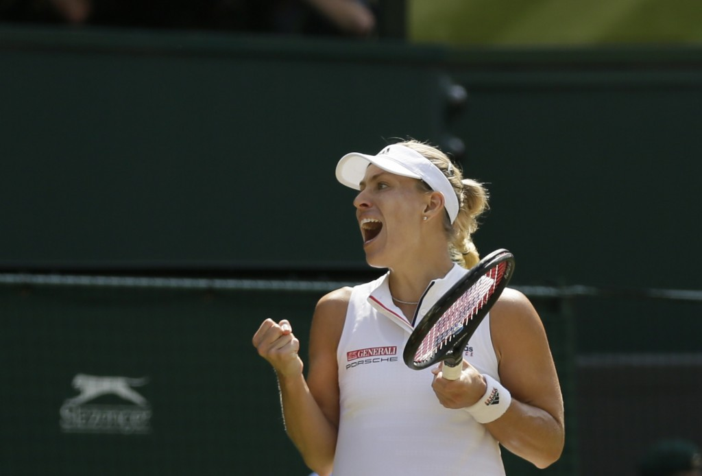 Germany's Angelique Kerber celebrates defeating Latvia's Jelena Ostapenko during their women's singles semifinals match at the Wimbledon Tennis Champi