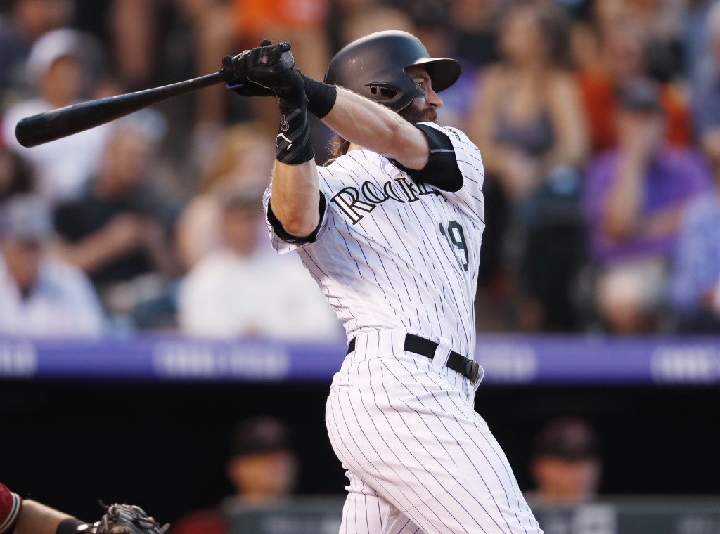 Colorado Rockies' Charlie Blackmon watches his two-run home run off Arizona Diamondbacks relief pitcher Jorge De La Rosa during the third inning of a