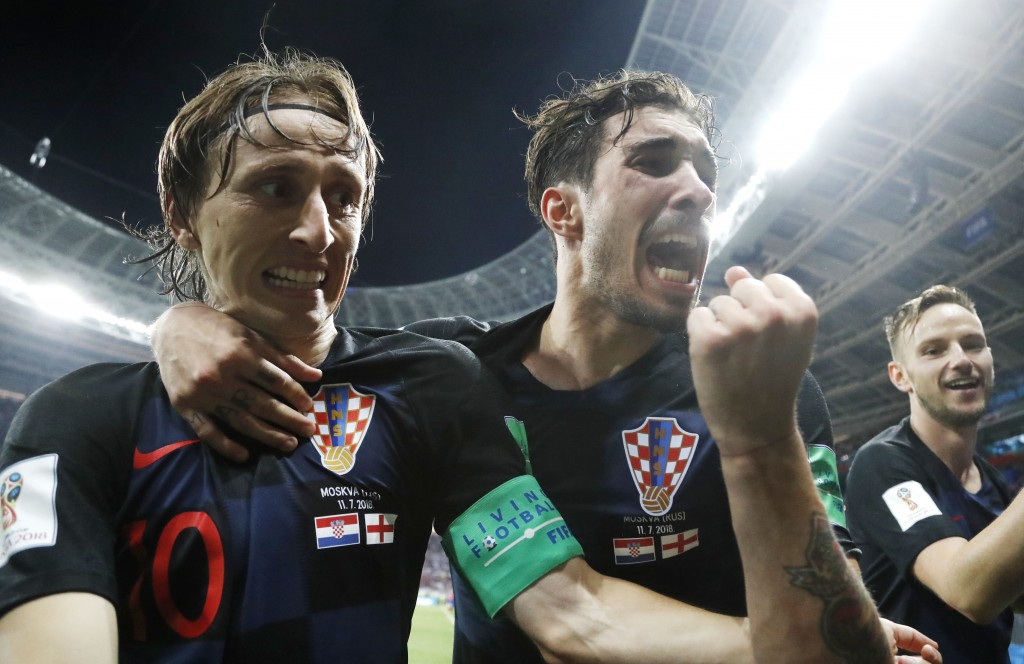 Croatia's Luka Modric, left, Sime Vrsaljko and Ivan Rakitic, right, celebrate after Croatia's Mario Mandzukic scored his side's second goal during the