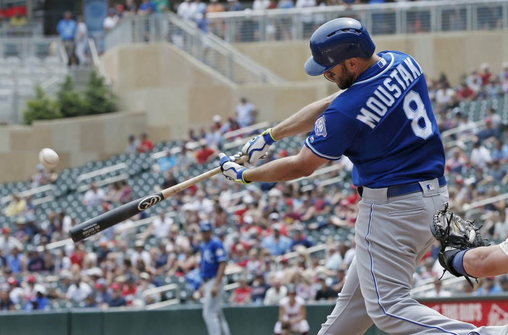 Kansas City Royals' Mike Moustakas hits a solo home run off Minnesota Twins pitcher Lance Lynn in the third inning of a baseball game Wednesday, July