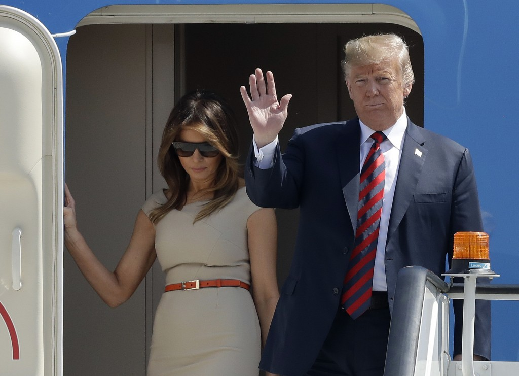 U.S. President Donald Trump and First Lady Melania Trump disembark from Air Force One as they arrive at London Stansted Airport in Stansted, England,