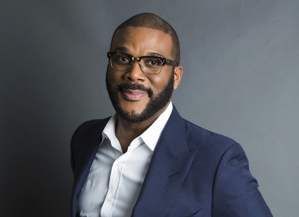 "FILE - In this Nov. 16, 2017, file photo, actor-filmmaker and author Tyler Perry poses for a portrait in New York to promote his book, ""Higher Is Wait"