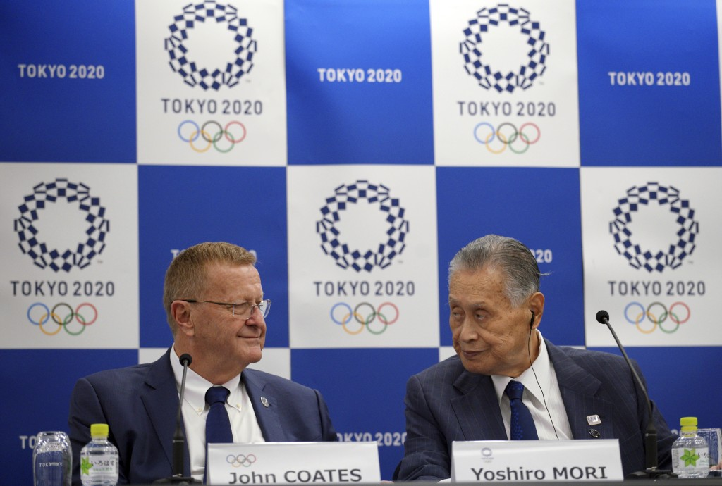 John Coates, left, chairman of the IOC Coordination Commission for the 2020 Tokyo Olympics and Paralympics and Tokyo Olympic organizing committee Pres