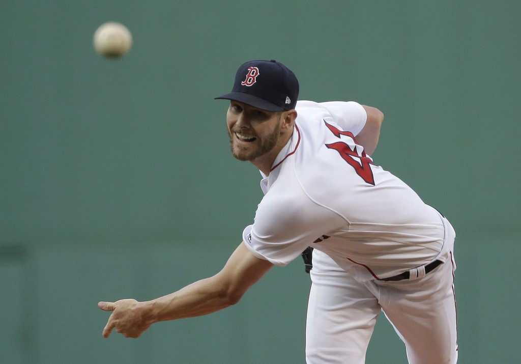Boston Red Sox starting pitcher Chris Sale watches a throw during the first inning of the team's baseball game against the Texas Rangers, Wednesday, J