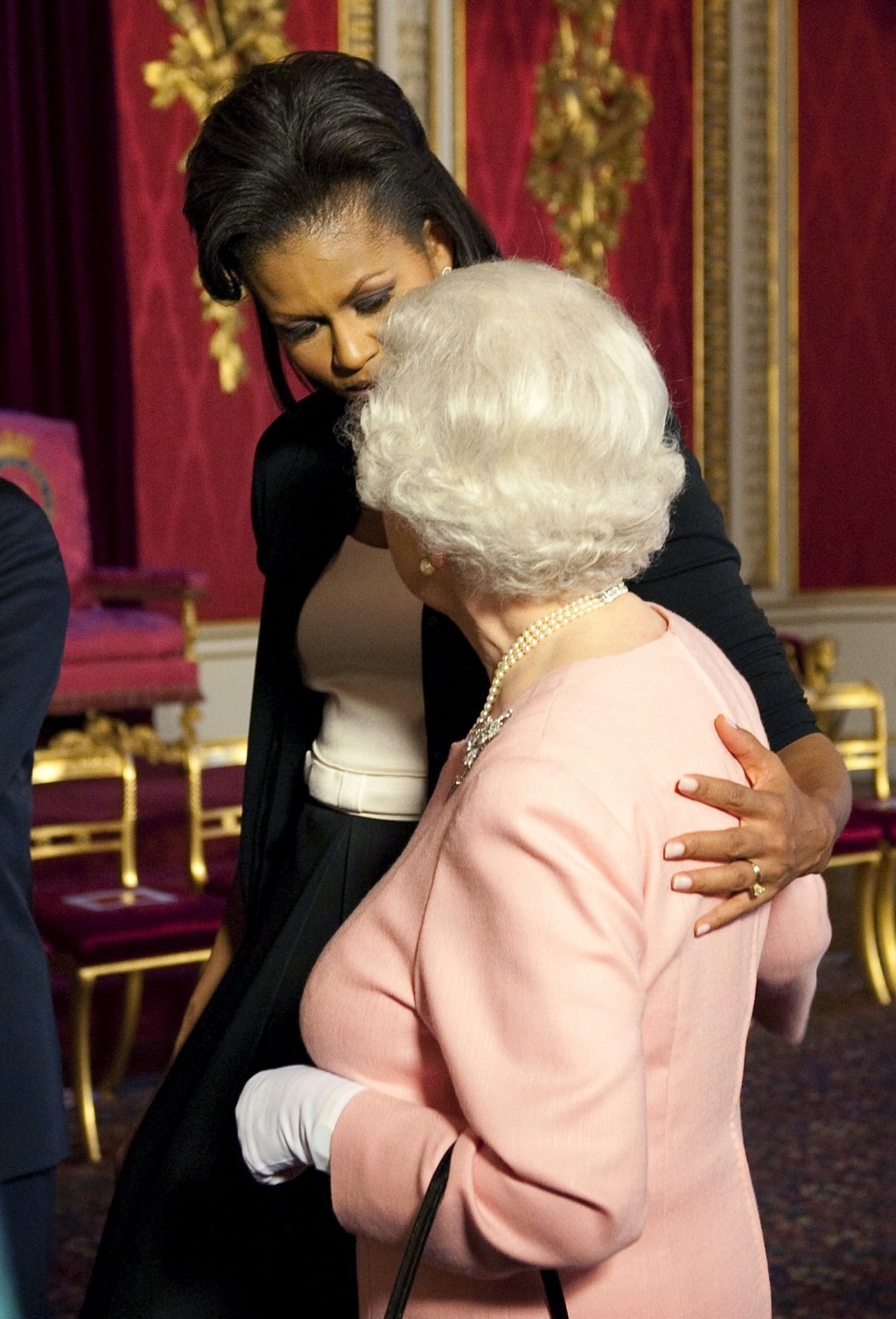 FILE  - In this Wednesday, April 1, 2009 file photo, Michelle Obama, wife of U.S. President Barack Obama, left, walks with Britain's Queen Elizabeth I