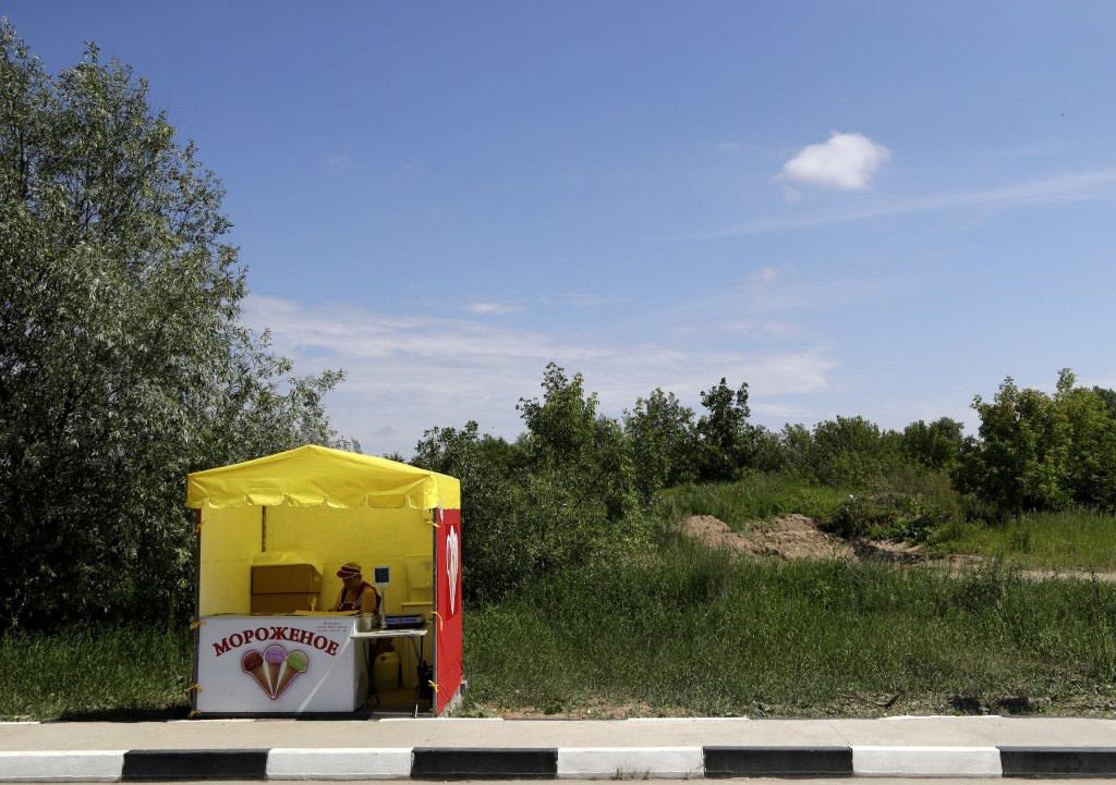 An ice cream seller waits for customers by the side of the road during the 2018 soccer World Cup at the in Nizhny Novgorod, Russia, Saturday, July 7,