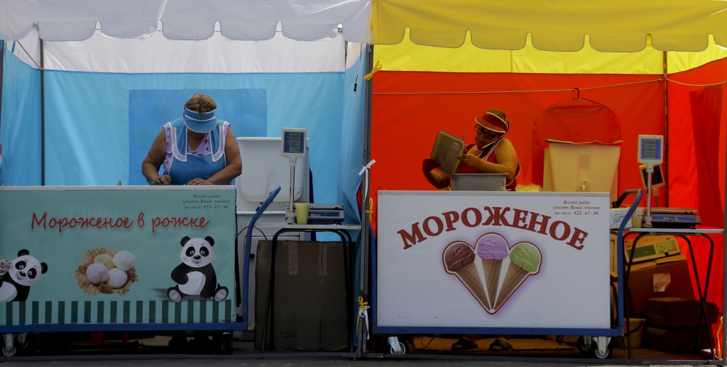 Two ice cream sellers prepare for business at their stand during the 2018 soccer World Cup in Nizhny Novgorod, Russia, Saturday, July 7, 2018. (AP Pho
