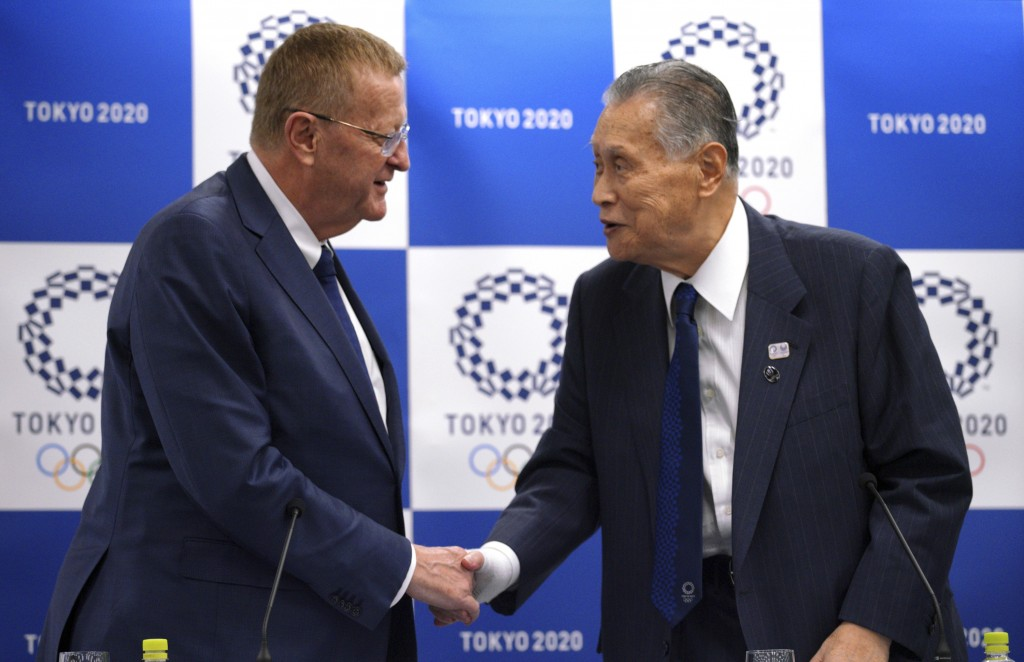 John Coates, left, chairman of the IOC Coordination Commission for the 2020 Tokyo Olympics and Paralympics, and Tokyo Olympic organizing committee Pre