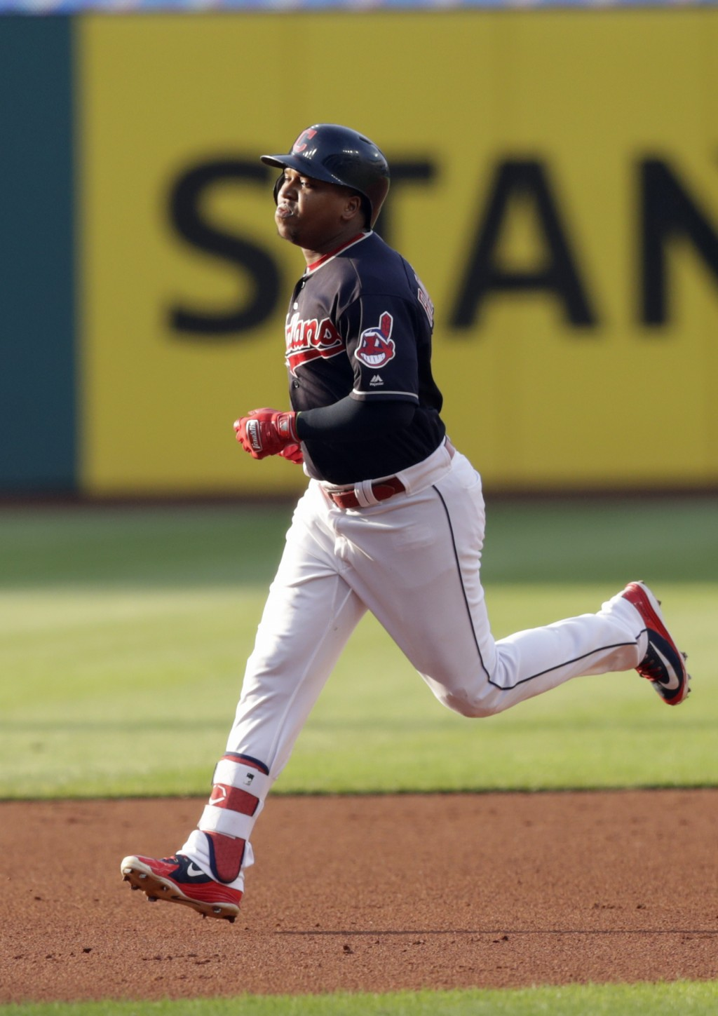 Cleveland Indians' Jose Ramirez runs the bases after hitting a two-run home run off Cincinnati Reds starting pitcher Tyler Mahle during the first inni