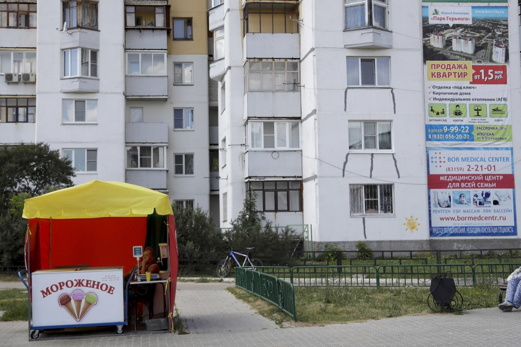 An ice cream seller waits for customers during the 2018 soccer World Cup at the in Nizhny Novgorod, Russia, Wednesday, July 4, 2018. (AP Photo/Petr Da