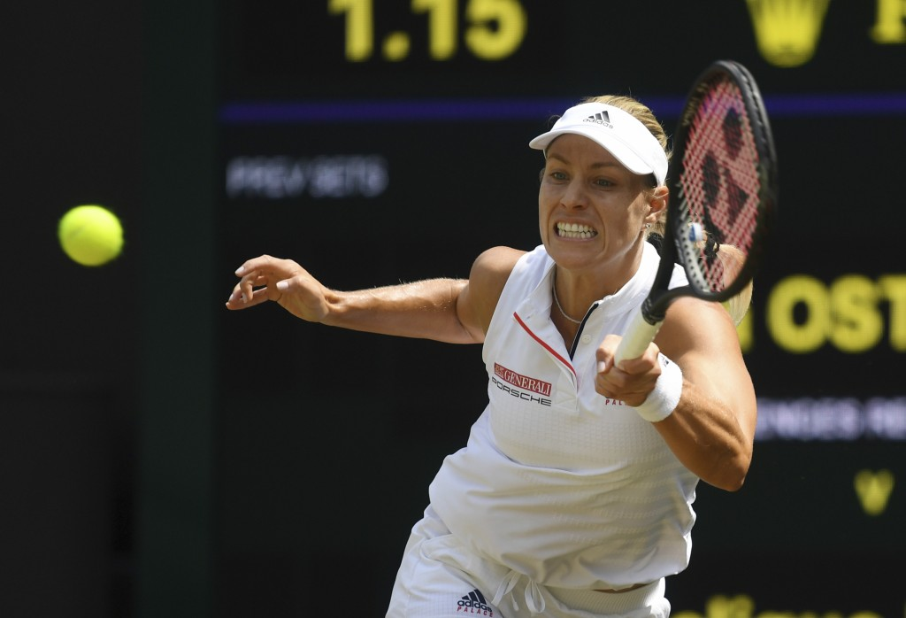 Angelique Kerber of Germany returns the ball to Jelena Ostapenko of Latvia during their women's semifinal match at the Wimbledon Tennis Championships