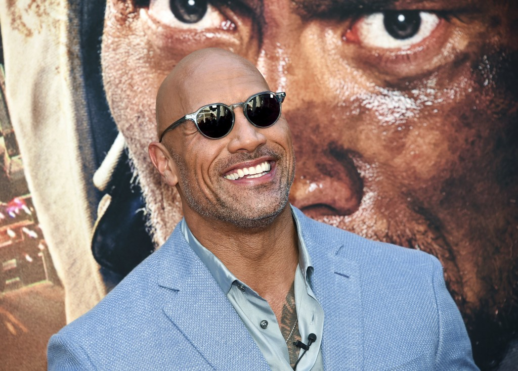 """FILE - In this July 10, 2018 file photo, Actor Dwayne Johnson attends the """"Skyscraper"""" premiere in New York. Johnson, who plays an amputee in the acti"""