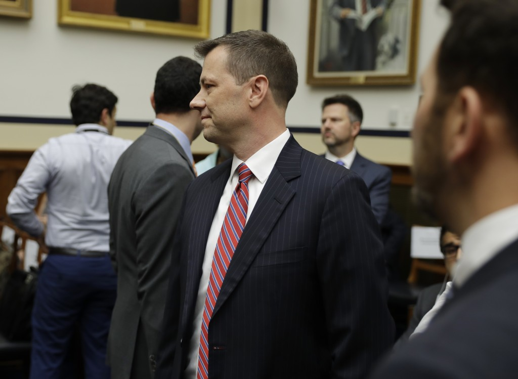 FBI Deputy Assistant Director Peter Strzok, center, arrives to a hearing of the House Committees on the Judiciary and Oversight and Government Reform