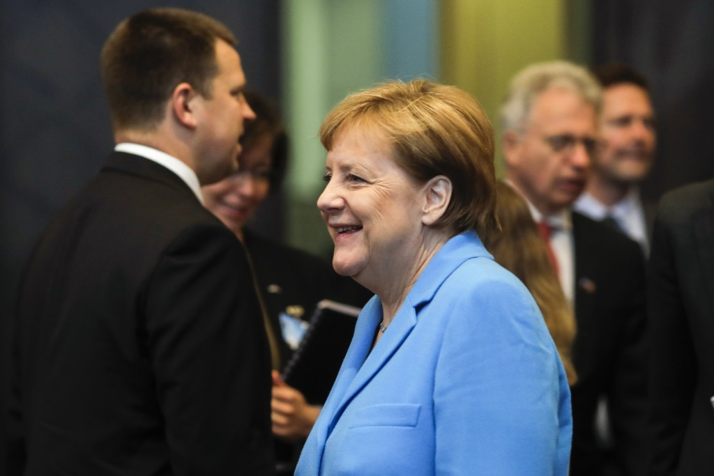 CORRECTS DATE - erman Chancellor Angela Merkel arrives for a working session during a summit of heads of state and government at NATO headquarters in