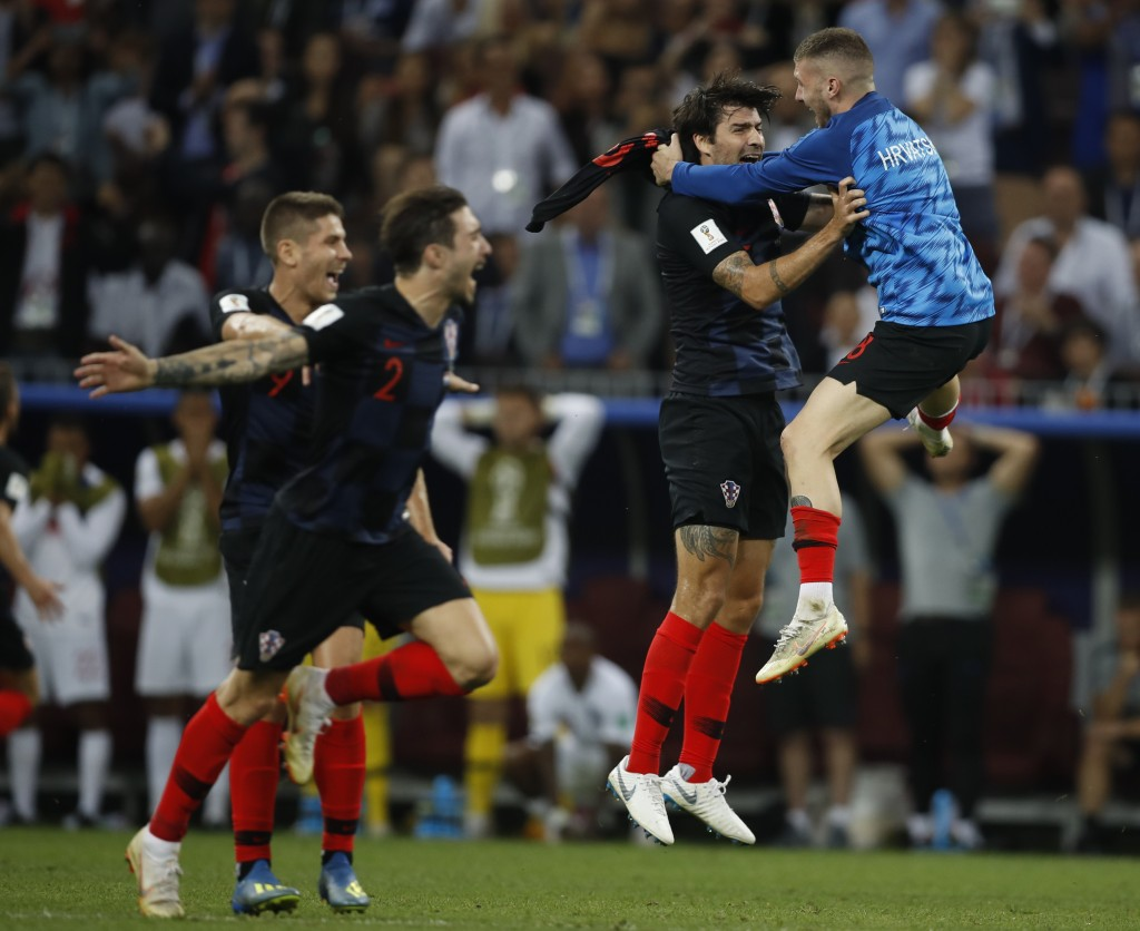 Players of Croatia celebrate after the semifinal match between Croatia and England at the 2018 soccer World Cup in the Luzhniki Stadium in Moscow, Rus