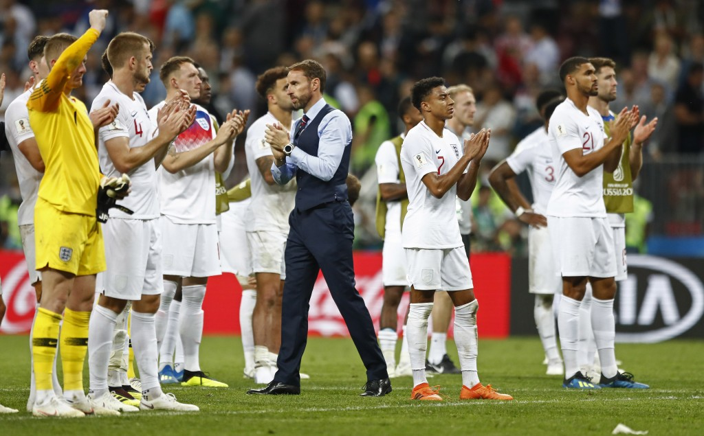England head coach Gareth Southgate walks between his players disappointed after losing the semifinal match between Croatia and England at the 2018 so