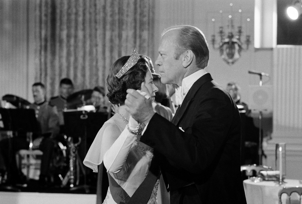 FILE - In this file photo dated July 7, 1976, U.S. President Gerald Ford dances with Britain's Queen Elizabeth II in the State Dining Room at the Whit