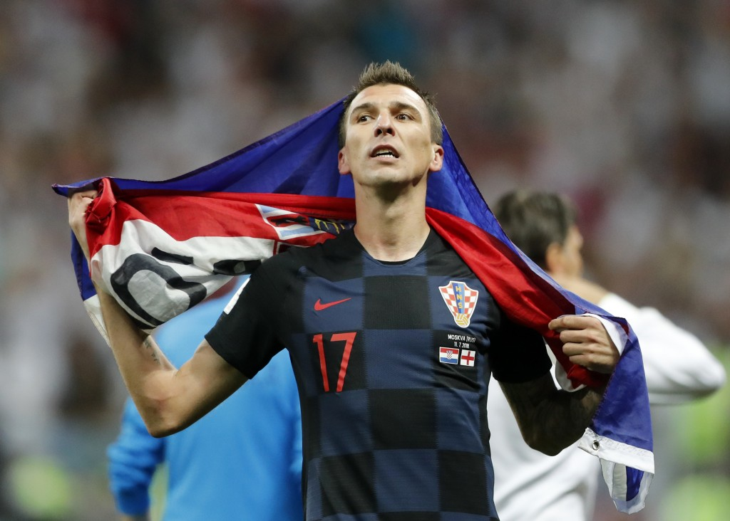 Croatia's Mario Mandzukic celebrates after his team advanced to the final during the semifinal match between Croatia and England at the 2018 soccer Wo