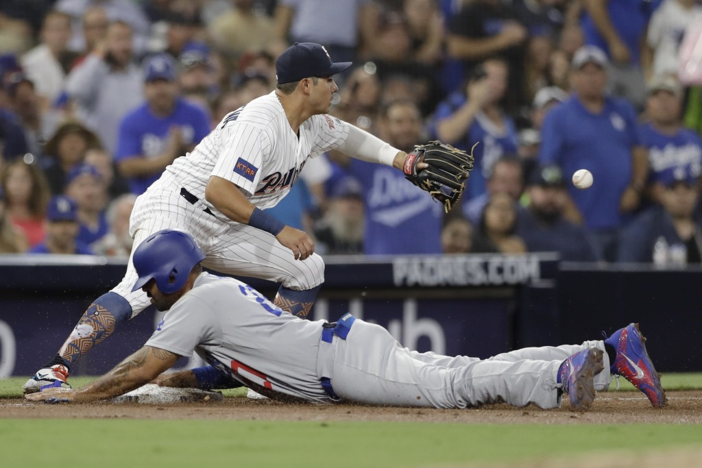 Los Angeles Dodgers' Matt Kemp reaches third from first on a single by Max Muncy as San Diego Padres third baseman Christian Villanueva waits for the