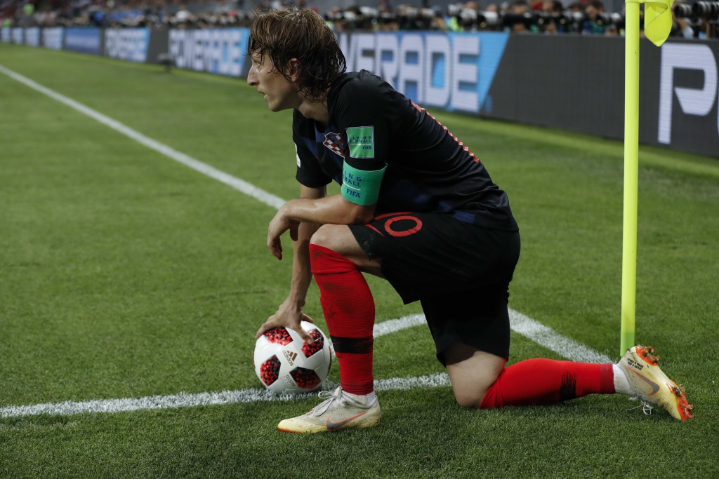 Croatia's Luka Modric holds the ball during the semifinal match between Croatia and England at the 2018 soccer World Cup in the Luzhniki Stadium in Mo