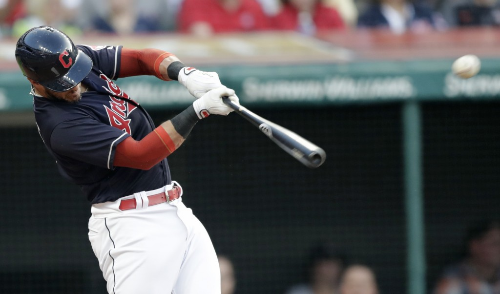 Cleveland Indians' Yan Gomes hits a two-run single off Cincinnati Reds starting pitcher Tyler Mahle during the third inning of a baseball game Wednesd