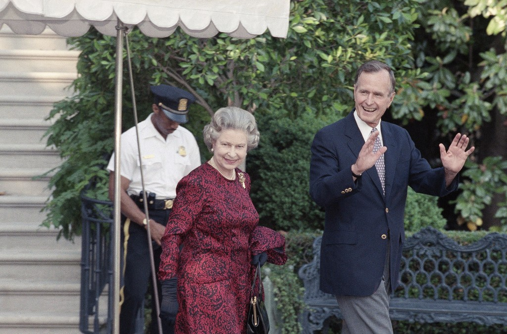 FILE - In this Wednesday, 15, 1991 file photo, US  President George H.W. Bush escorts Queen Elizabeth II from the White House to a helicopter enroute
