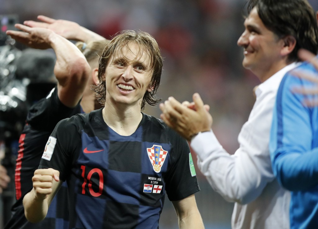 Croatia's Luka Modric celebrates with head coach Zlatko Dalic after advancing to the final during the semifinal match between Croatia and England at t