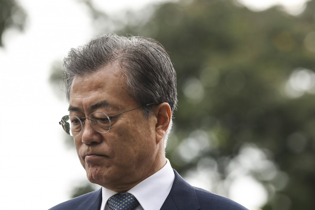 South Korea's President Moon Jae-in arrives at the Istana or Presidential Palace in Singapore, Thursday, July 12, 2018. (AP Photo/Yong Teck Lim)