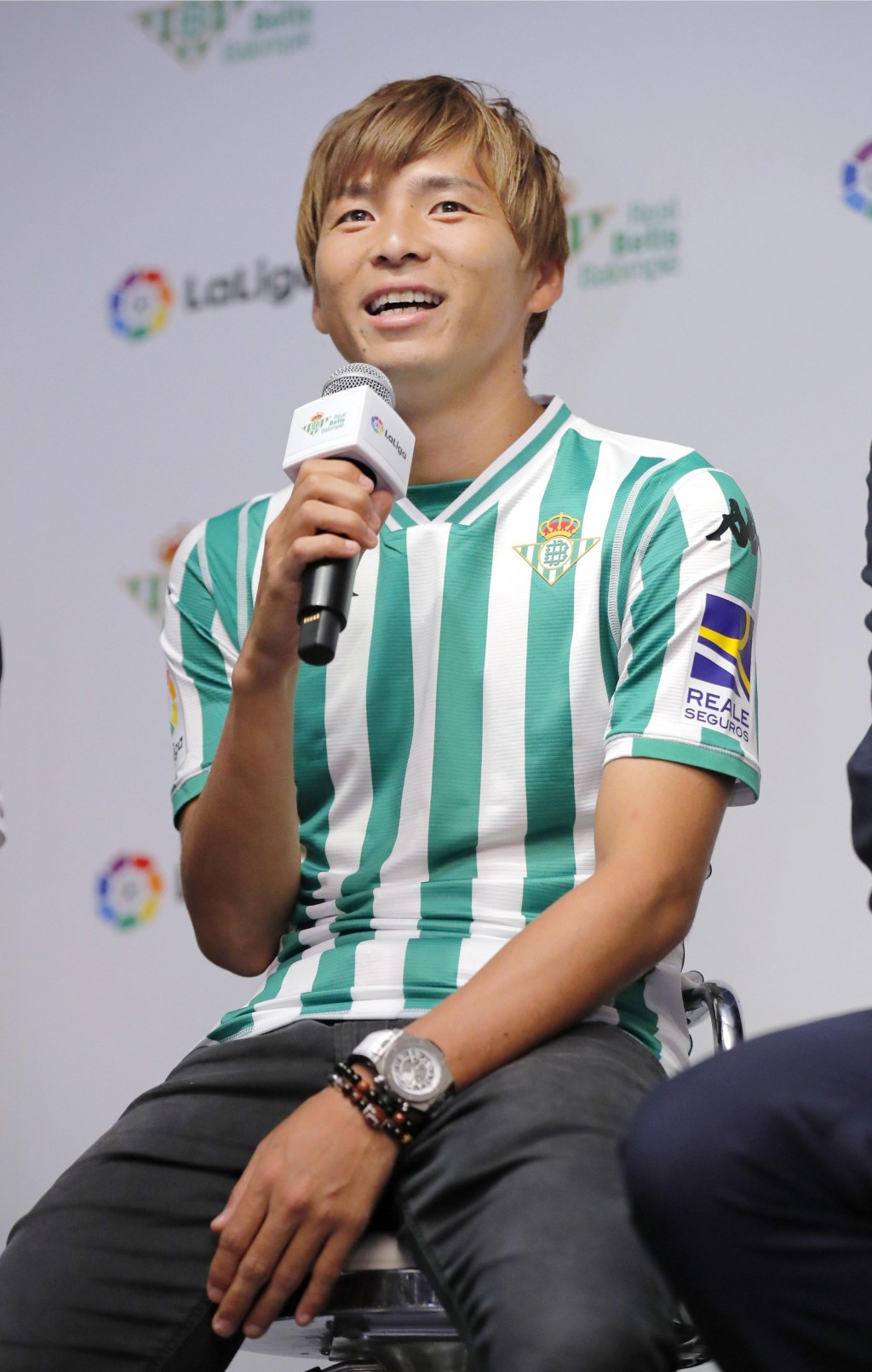 Japan's Takashi Inui speaks wearing Real Betis' shirt as he received from the team's Business General Manager Ramon Alarcon, at the Spanish embassy in