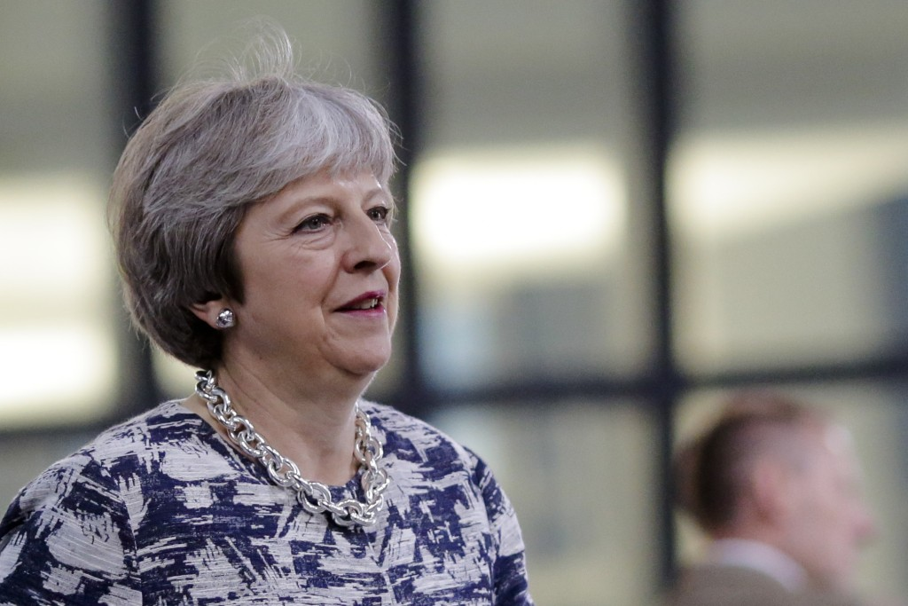 British Prime Minister Theresa May walks through the NATO headquarters prior to working session of a NATO a summit of heads of state and government in