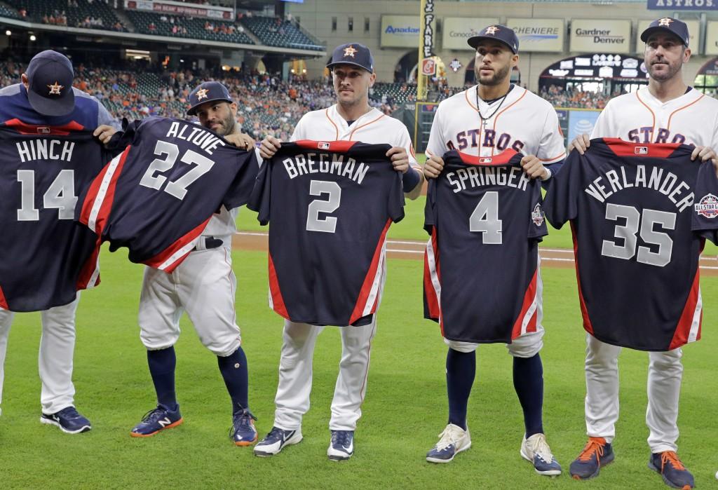 Houston Astros All-Stars AJ Hinch (14), Jose Altuve (27), Alex Bregman (2), George Springer (4) and Justin Verlander (35) pose with their All-Star jer