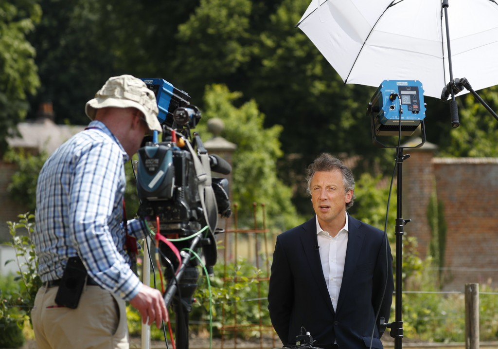 Tom Newton Dunn, Political Editor of the Sun Newspaper, right, is seen speaking to Fox Television News network at Chequers, in Buckinghamshire, Englan