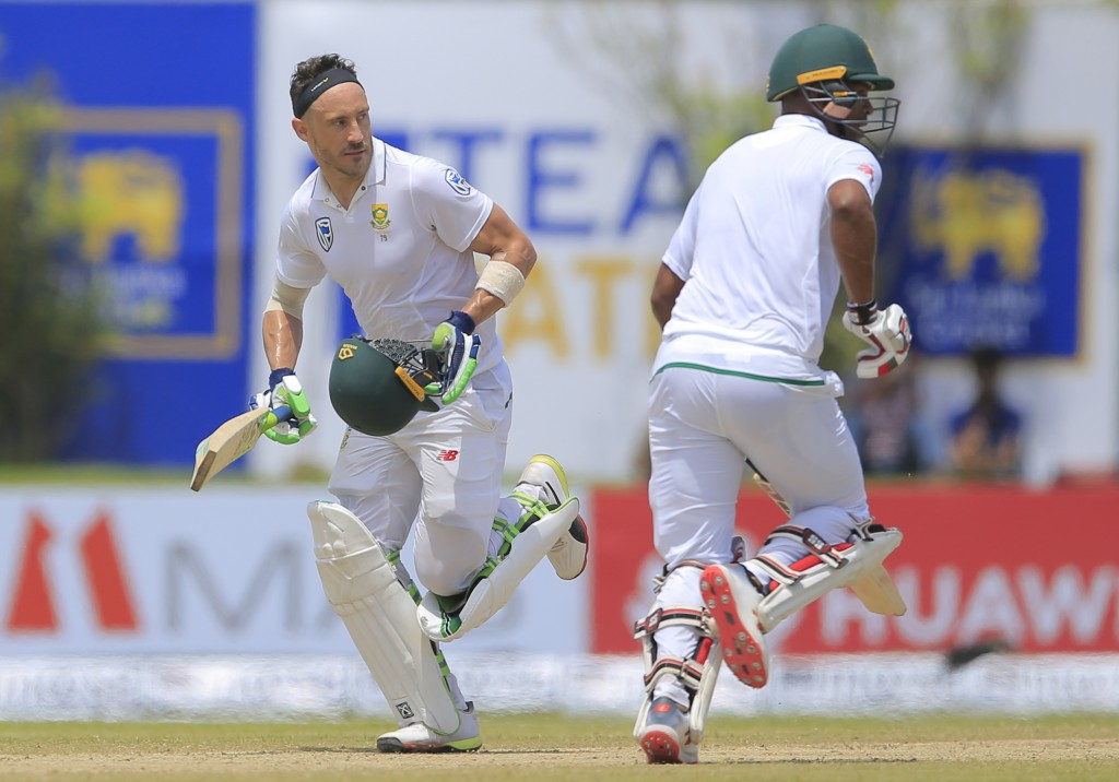 South Africa's captain Fuf du Pleases, left, and Vernon Philander run between the wickets during the second day of their first test cricket match agai