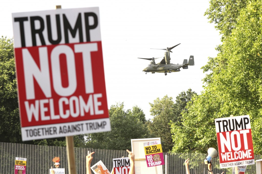 A helicopter leaves the grounds of the US ambassador residence in Regent's Park, London, while demonstrators protest against the visit of US President