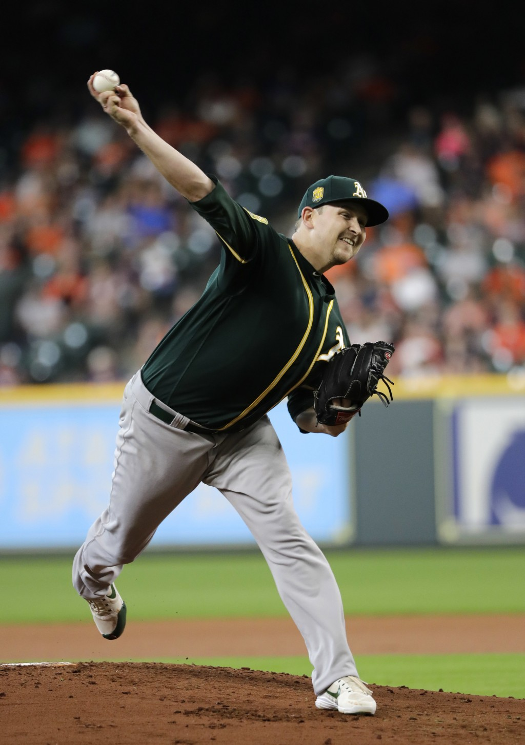 Oakland Athletics starting pitcher Trevor Cahill throws against the Houston Astros during the first inning of a baseball game Thursday, July 12, 2018,