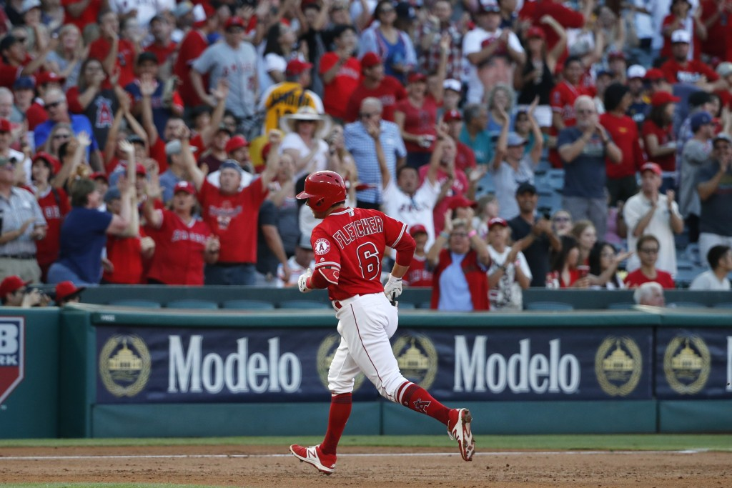 Los Angeles Angels' David Fletcher rounds the bases after hitting his first career home run during the first inning of the team's baseball game agains