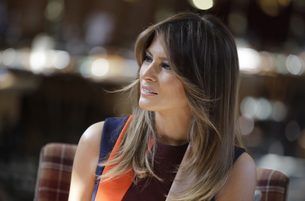 U.S. First Lady Melania Trump takes a seat during a visit to The Royal Hospital Chelsea in central London Friday, July 13, 2018. (AP Photo/Luca Bruno,