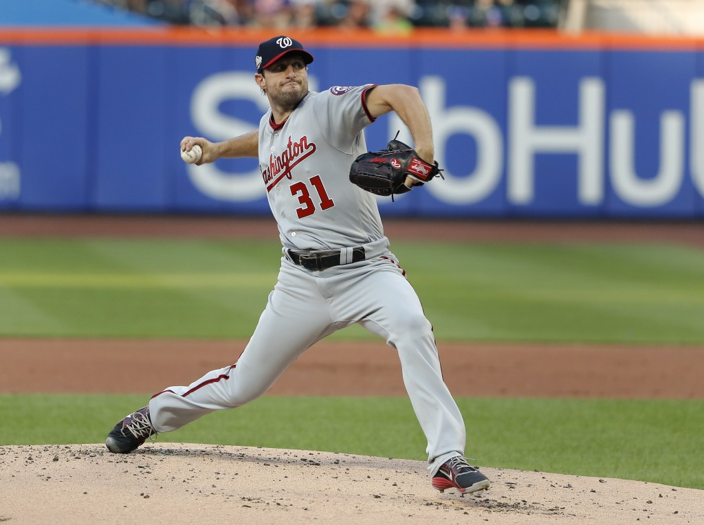 Washington Nationals starting pitcher Max Scherzer delivers against the New York Mets during the first inning of a baseball game Thursday, July 12, 20