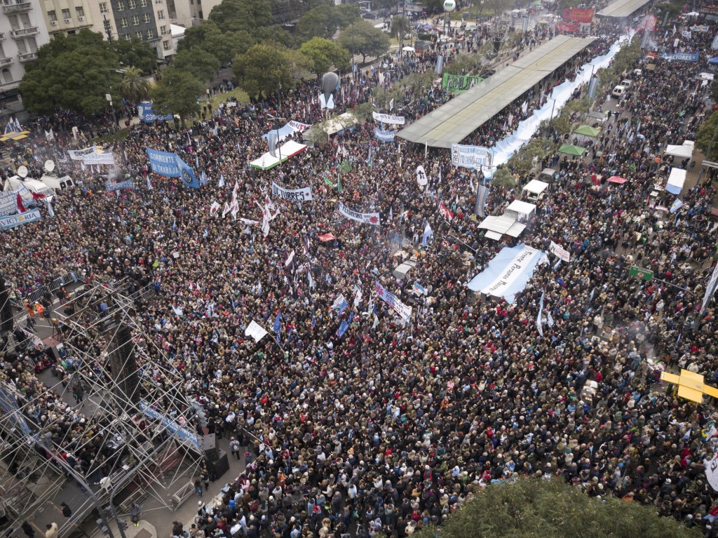 In this July 9, 2018 photo, people gather for a demonstration against International Monetary Fund, IMF, during Argentina's Independence Day, in Buenos