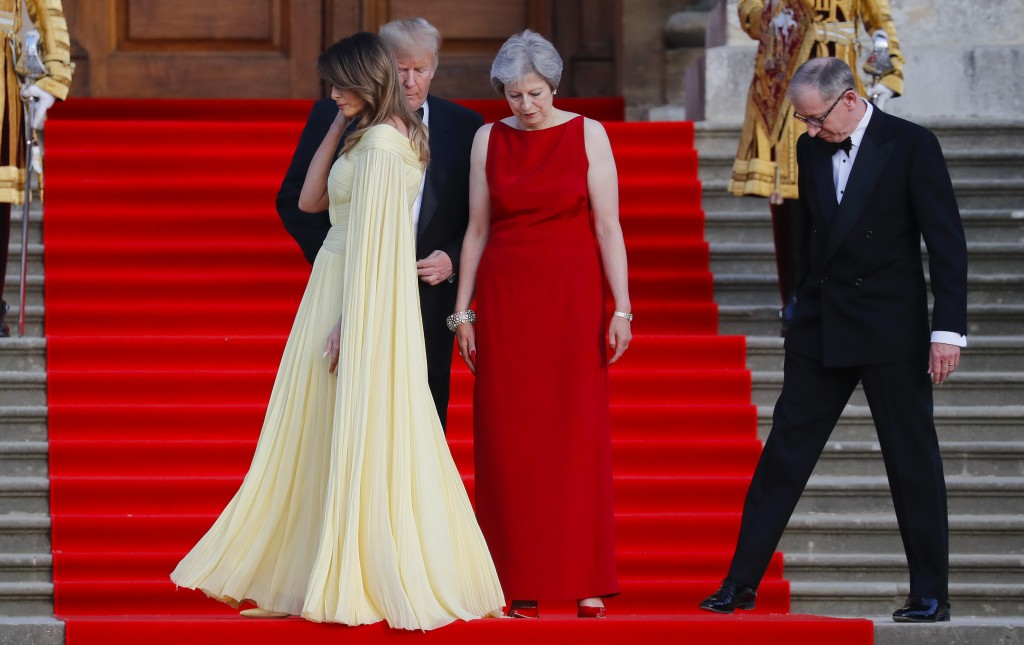First lady Melania Trump, left, walks past President Donald Trump, British Prime Minister Theresa May, and May's husband Philip May, during the arriva