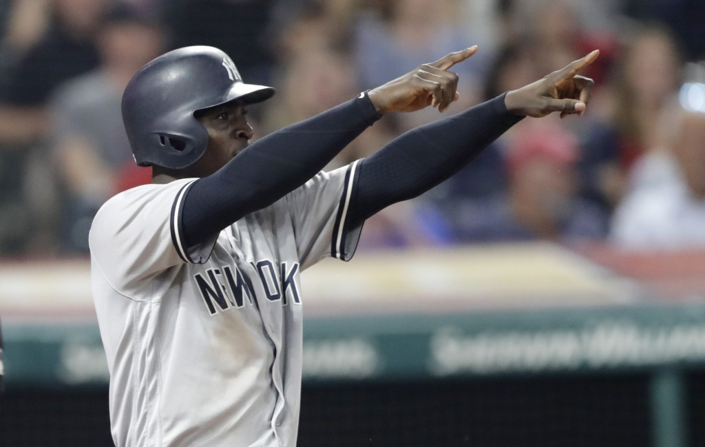 New York Yankees' Didi Gregorius looks toward Aaron Hicks at second base after Gregorius scored on a double by Hicks during the eighth inning of a bas