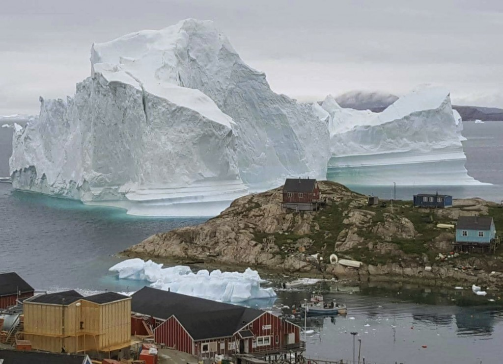 CAPTION CORRECTS PHOTOGRAPHER BYLINE In this Thursday, July 12, 2018 photo, a view of an Iceberg, near the village Innarsuit, on the northwestern Gree