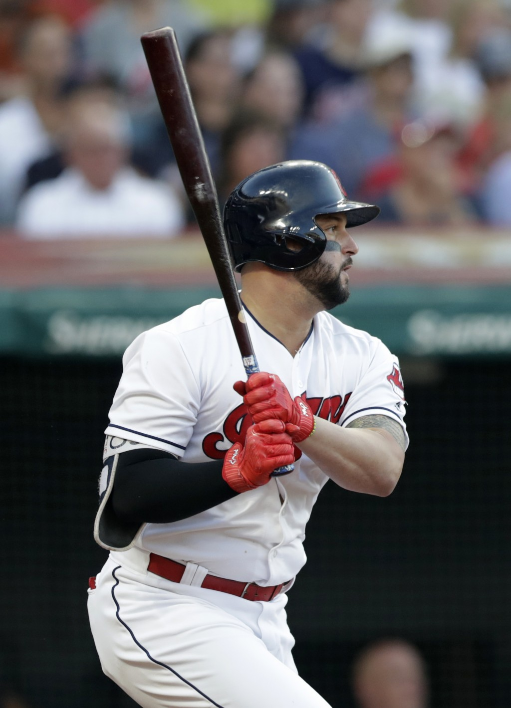 Cleveland Indians' Yonder Alonso watches his RBI-single off New York Yankees starting pitcher Luis Severino during the third inning of a baseball game