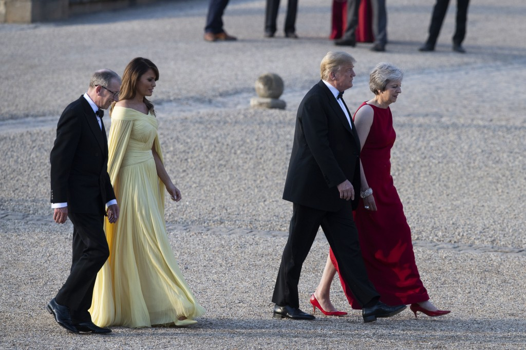 President Donald Trump, British Prime Minister Theresa May, front and first lady Melania Trump, and May's husband Philip May, arrive at Blenheim Palac