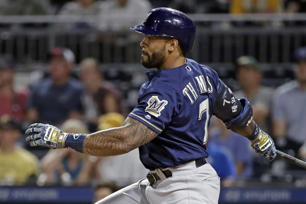 Milwaukee Brewers' Eric Thames watches his RBI single off Pittsburgh Pirates reliever Michael Feliz during the ninth inning of a baseball game in Pitt