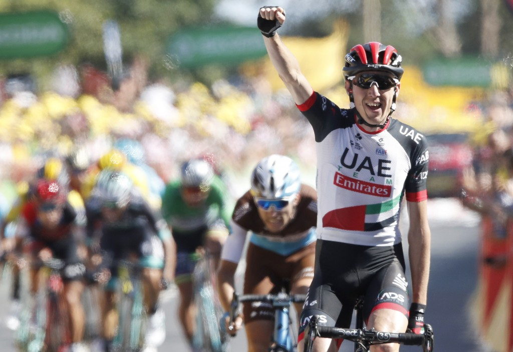 Ireland's Daniel Martin celebrates as he crosses the finish line to win the sixth stage of the Tour de France cycling race over 181 kilometers (112.5