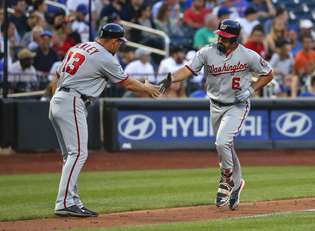 Washington Nationals' Anthony Rendon (6) is congratulated by third base coach Bob Henley (13) after hitting a solo home run against the New York Mets