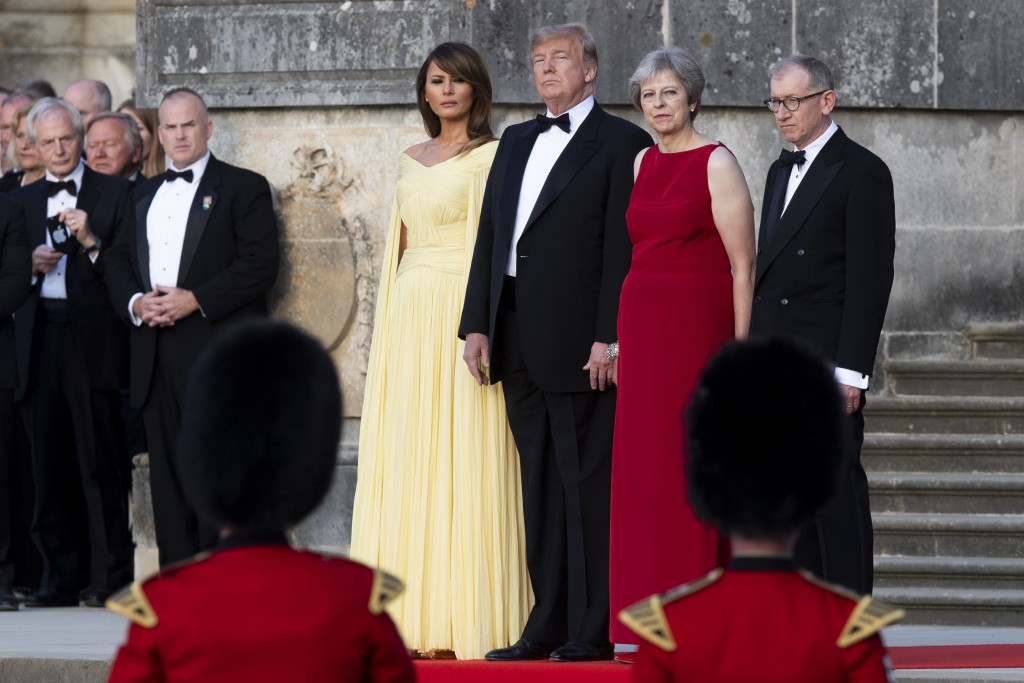 From left, first lady Melania Trump, President Donald Trump, British Prime Minister Theresa May, and her husband Philip May, watch the arrival ceremon...