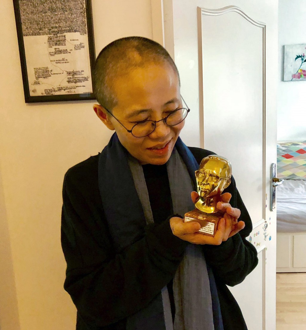 In this July 12, 2018, photo provided on July 13, 2018, by Tienchi Martin-Liao, Liu Xia, the widow of Nobel Peace Prize laureate Liu Xiaobo, holds an