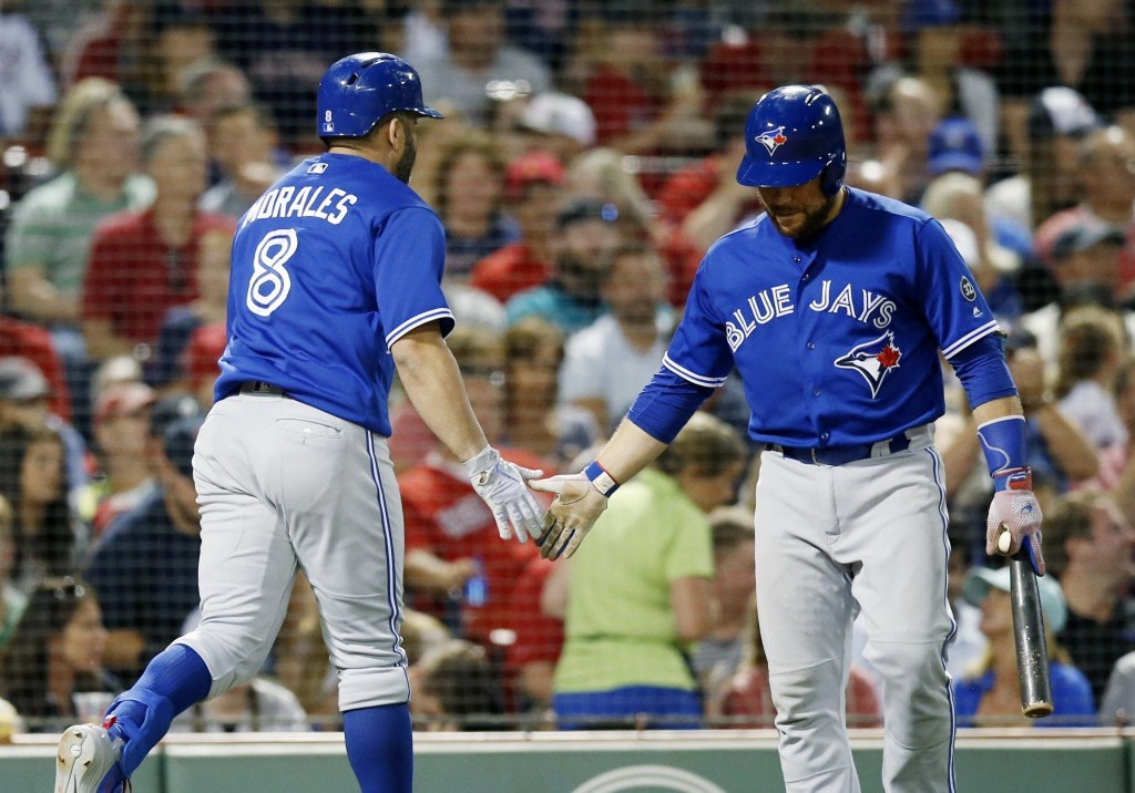 Toronto Blue Jays' Kendrys Morales (8) celebrates his solo home run with Russell Martin during the seventh inning of the team's baseball game against